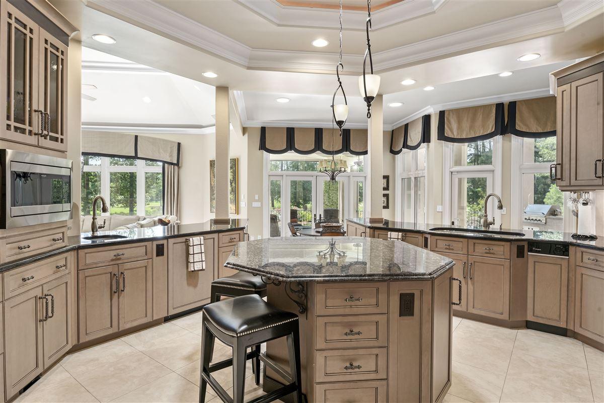 stunning custom home boasts sensational golf course views luxury properties