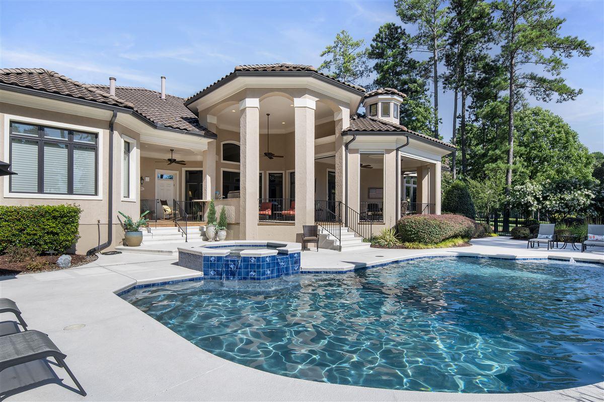 stunning custom home boasts sensational golf course views luxury real estate