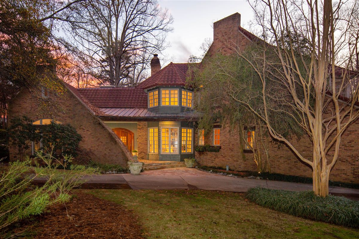 Luxury homes One of a kind European style all brick home perfectly sited