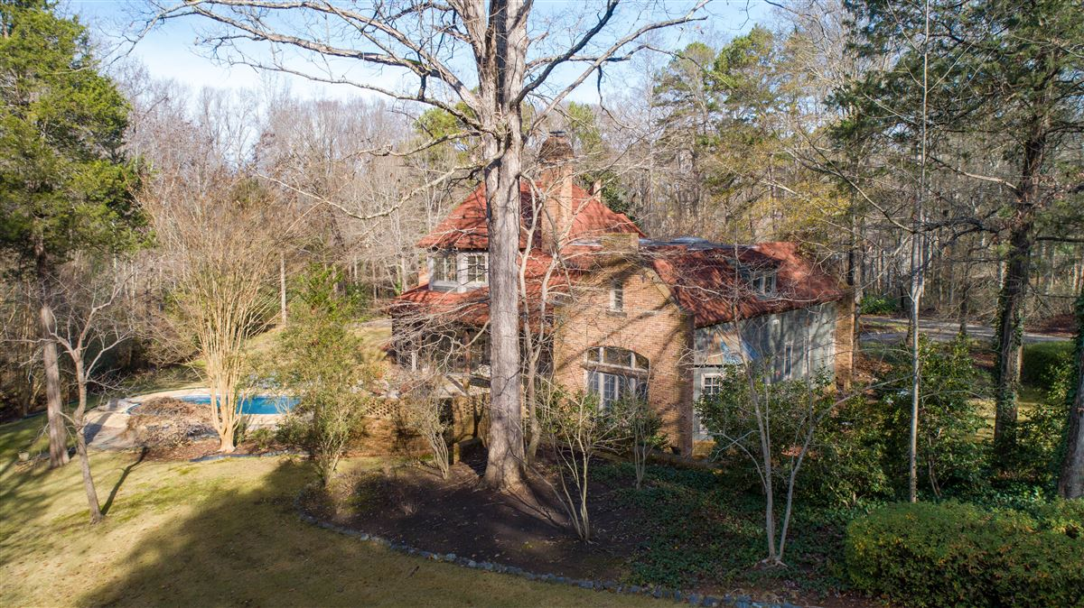One of a kind European style all brick home perfectly sited luxury real estate
