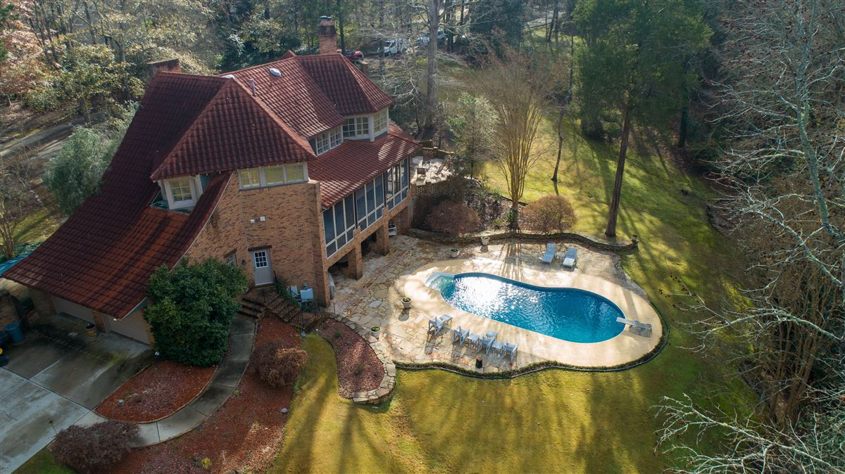 One of a kind European style all brick home perfectly sited luxury properties