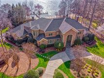 SOPHISTICATED HOME IN THE PENINSULA ON LAKE NORMAN luxury real estate