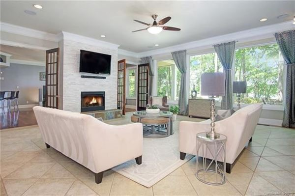 Luxury homes in Custom Waterfront Estate with Sweeping Views, Modern Amenities, & Wooded Privacy