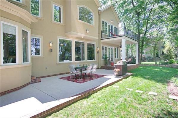 Luxury properties Custom Waterfront Estate with Sweeping Views, Modern Amenities, & Wooded Privacy