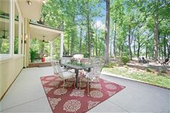 Luxury real estate Custom Waterfront Estate with Sweeping Views, Modern Amenities, & Wooded Privacy