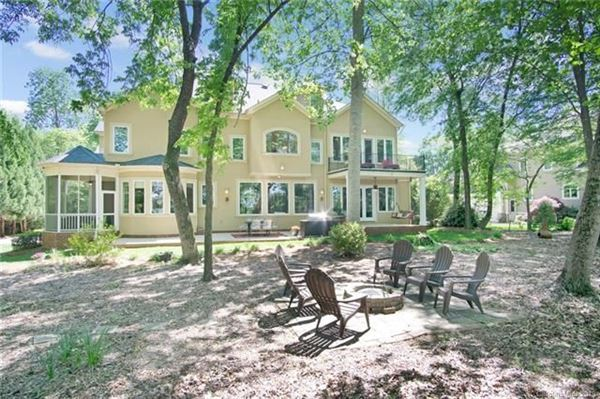 Mansions in Custom Waterfront Estate with Sweeping Views, Modern Amenities, & Wooded Privacy