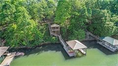 Mansions Custom Waterfront Estate with Sweeping Views, Modern Amenities, & Wooded Privacy