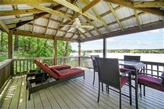 Custom Waterfront Estate with Sweeping Views, Modern Amenities, & Wooded Privacy mansions