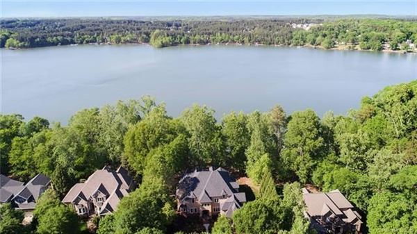 Luxury homes Custom Waterfront Estate with Sweeping Views, Modern Amenities, & Wooded Privacy