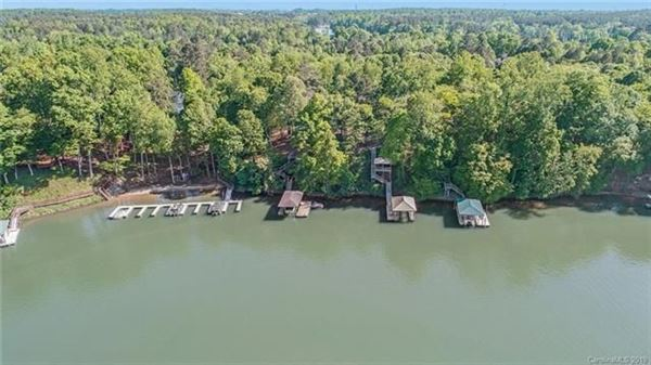 Custom Waterfront Estate with Sweeping Views, Modern Amenities, & Wooded Privacy luxury homes