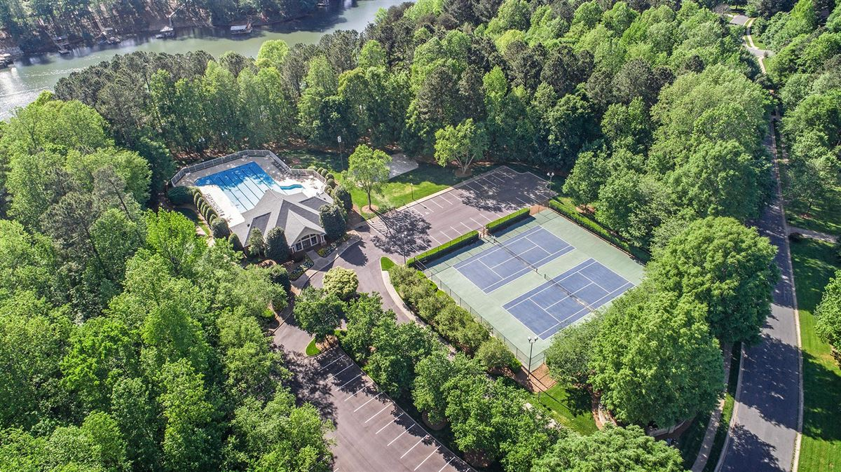 Custom Waterfront Estate with Sweeping Views, Modern Amenities, & Wooded Privacy luxury real estate