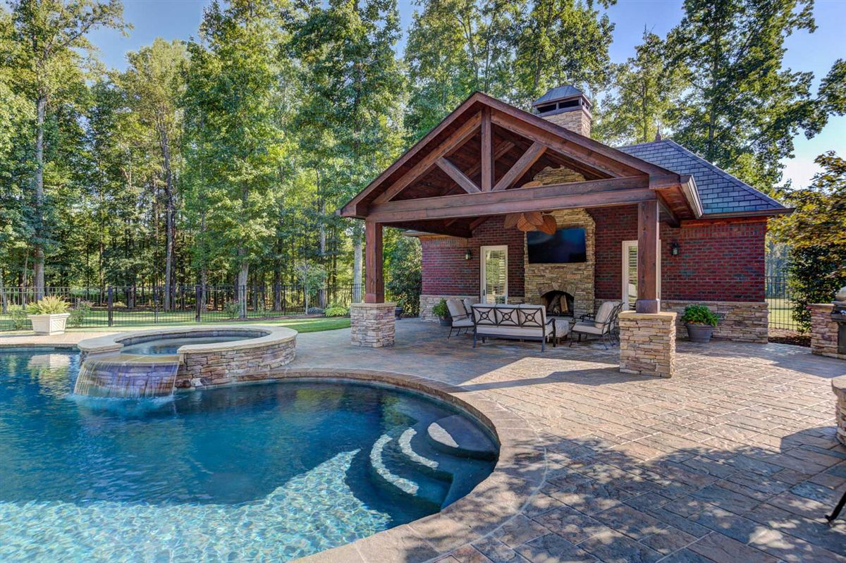Luxury homes this home offers a pool and pool house