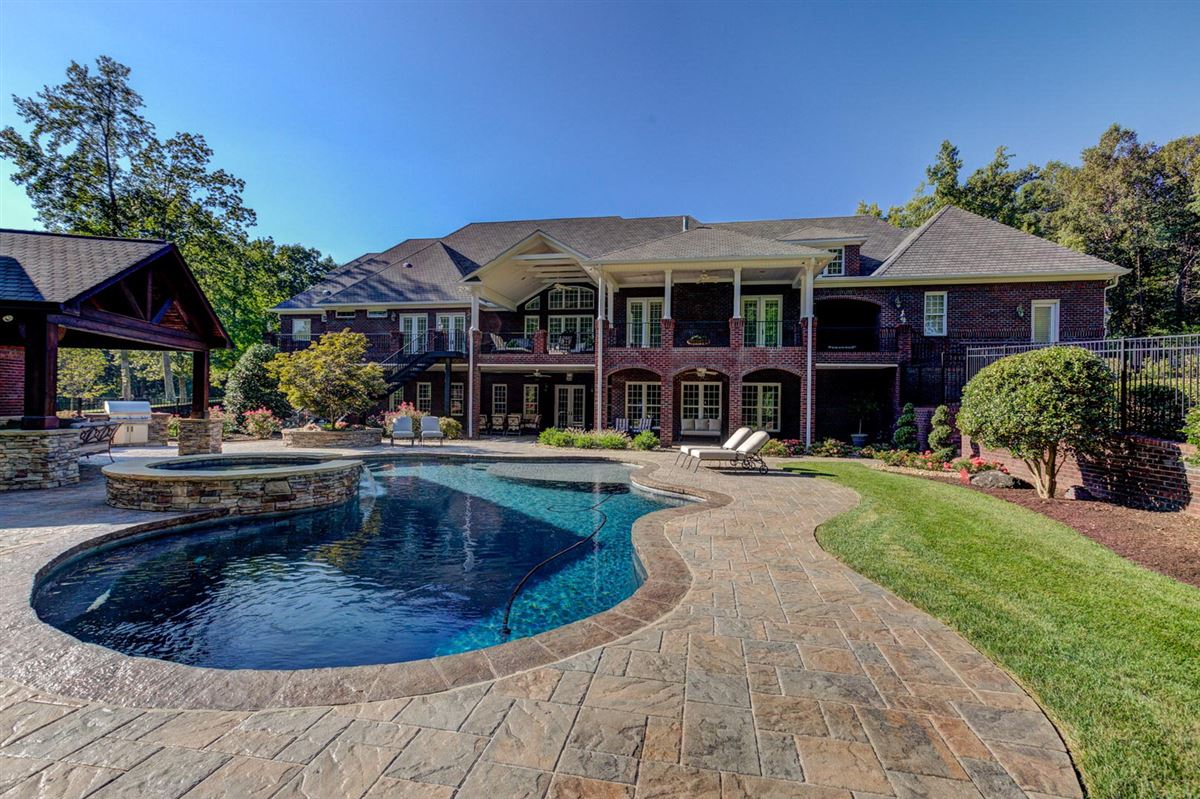 this home offers a pool and pool house luxury homes