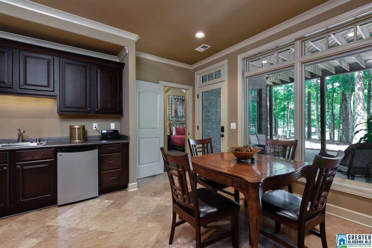 63 Acs. Custom High Ridge Estate on 30 Ac. Lake luxury properties