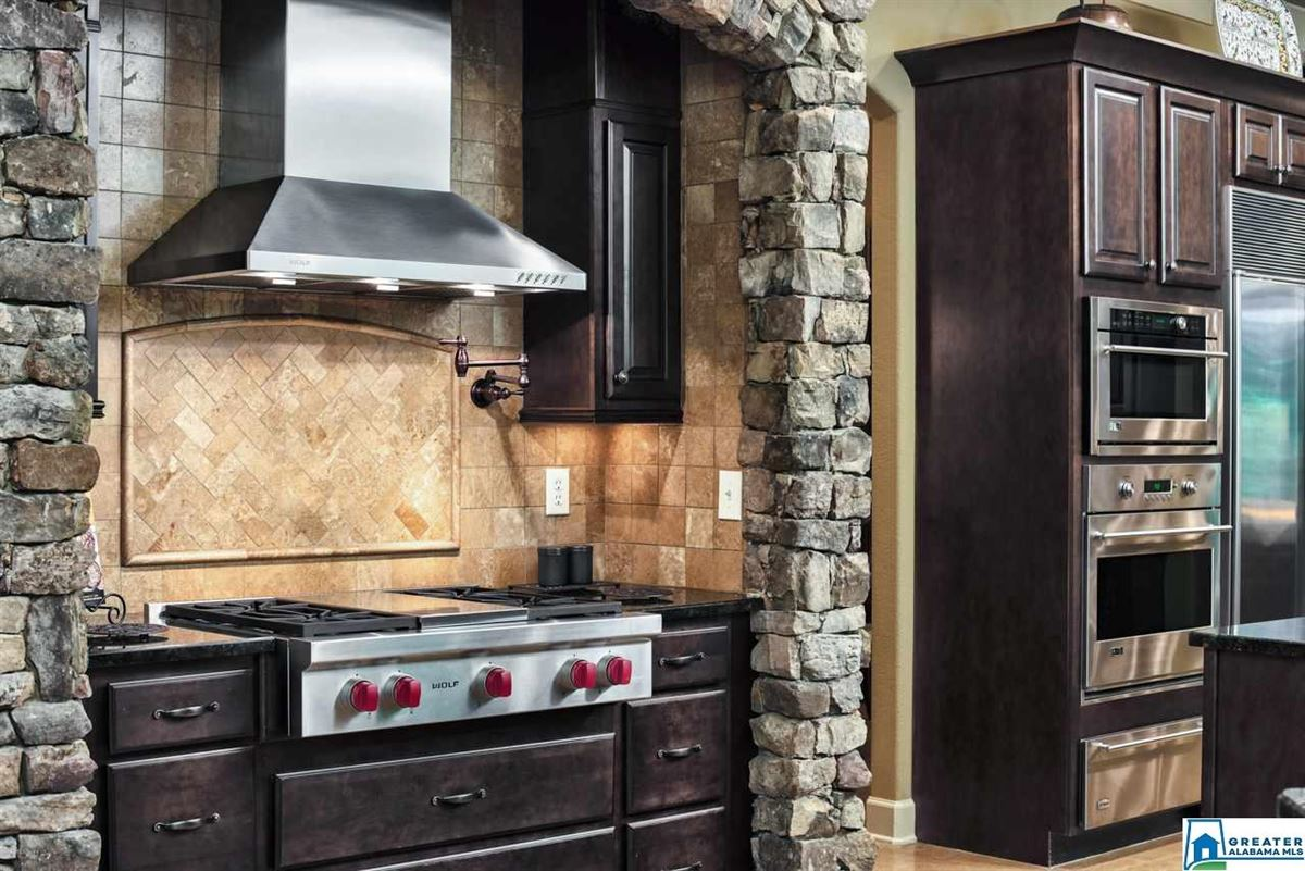 63 Acs. Custom High Ridge Estate on 30 Ac. Lake luxury real estate