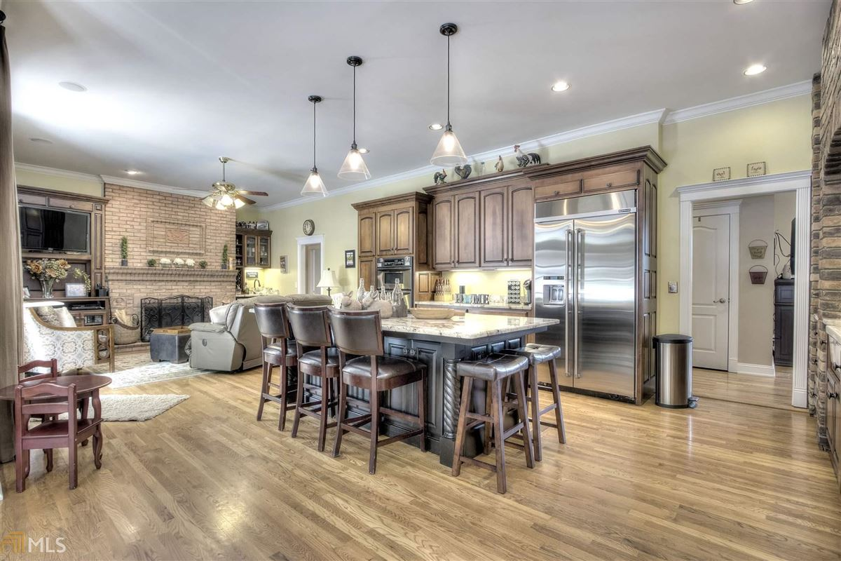 Luxury properties beautiful brick ranch on 28 private acres