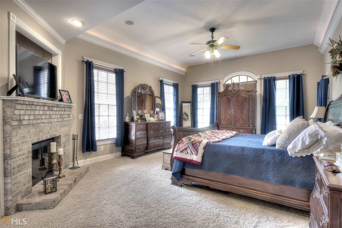 Luxury homes in beautiful brick ranch on 28 private acres