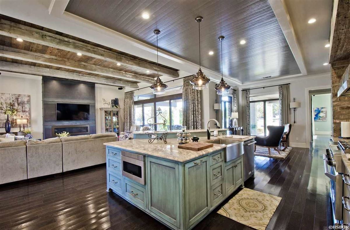 Mansions lovely custom home with lake hamilton frontage