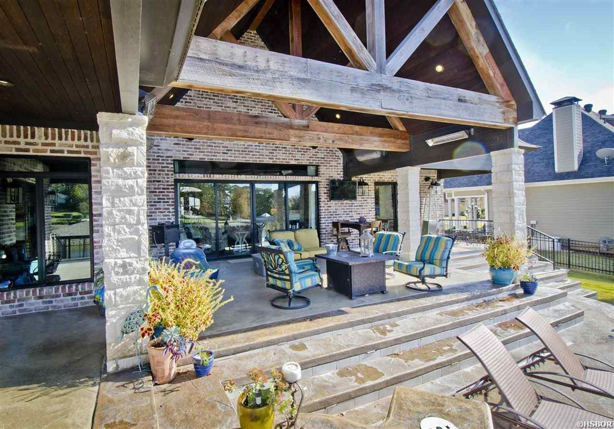 Luxury properties lovely custom home with lake hamilton frontage