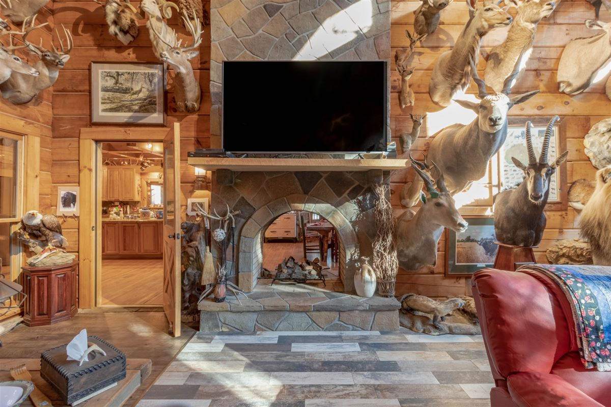 Beautiful custom home on 20-plus secluded acres mansions