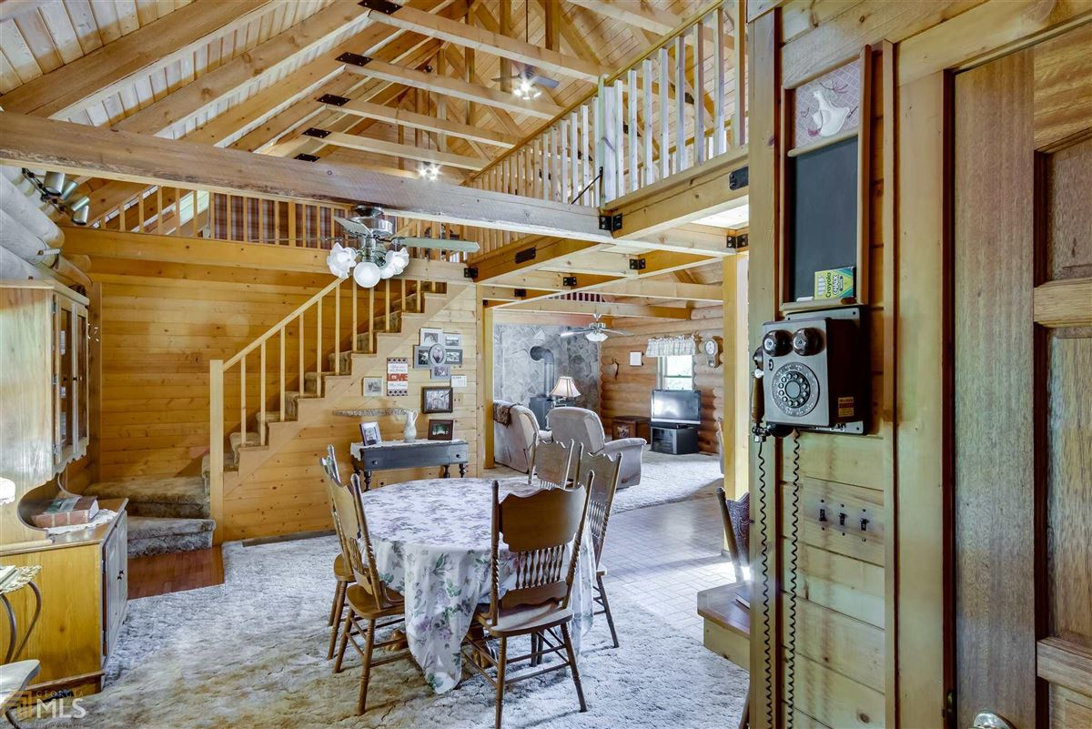 Luxury homes in log cabin retreat on 85 acres