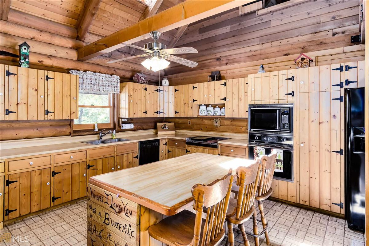 Mansions in log cabin retreat on 85 acres