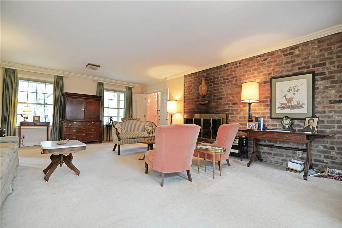 Luxury properties rare one-level all brick home