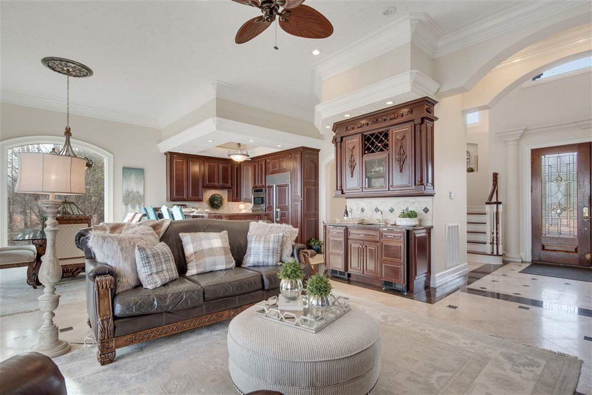 Luxury homes Exquisite waterfront home in gated Grand Villas