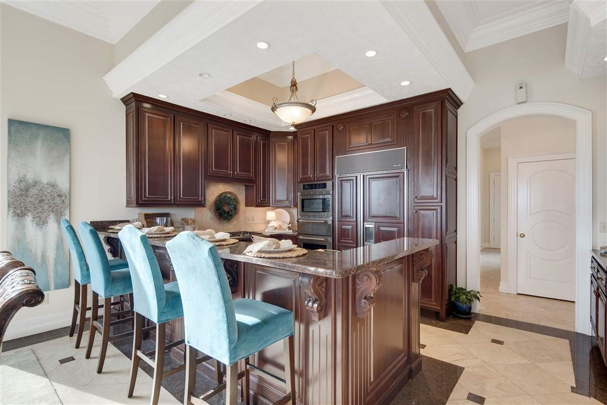 Luxury real estate Exquisite waterfront home in gated Grand Villas