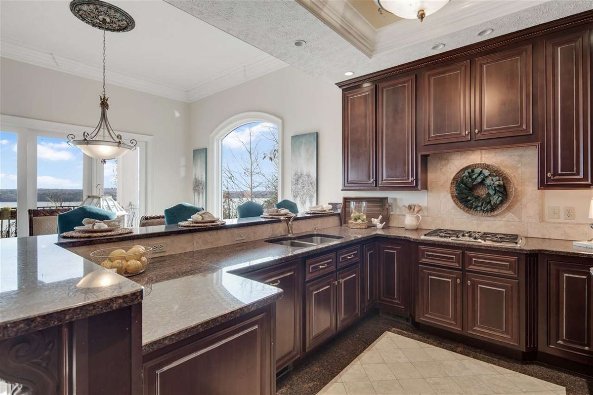 Exquisite waterfront home in gated Grand Villas luxury real estate