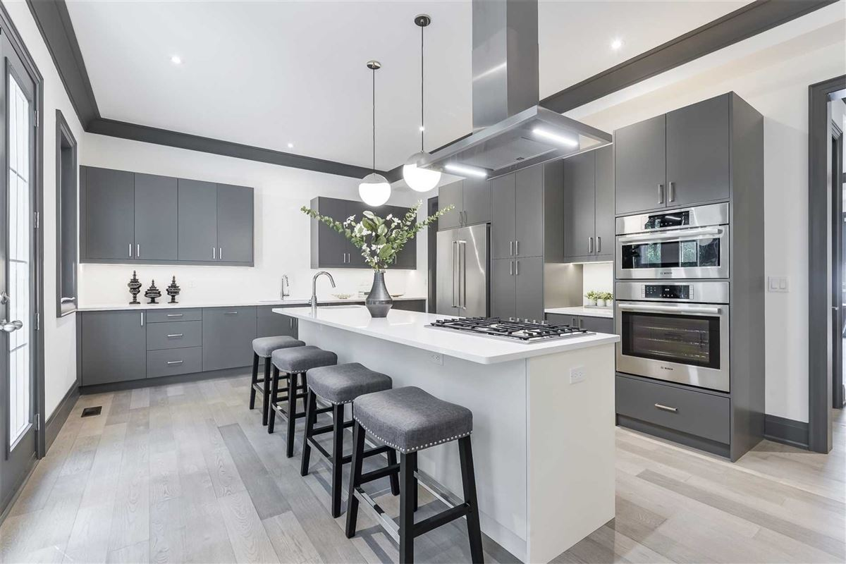 Luxury properties upgraded townhome on a treed lot