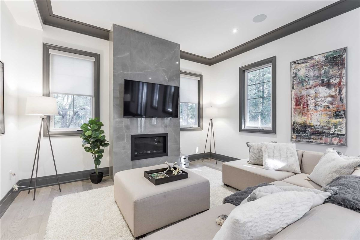 Luxury homes in upgraded townhome on a treed lot