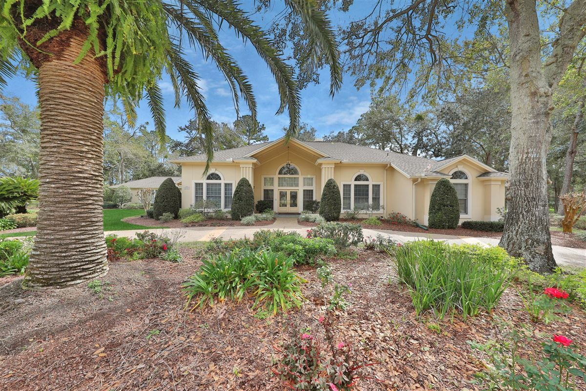 Luxury homes in beautiful lush landscaping surrounds this grand home
