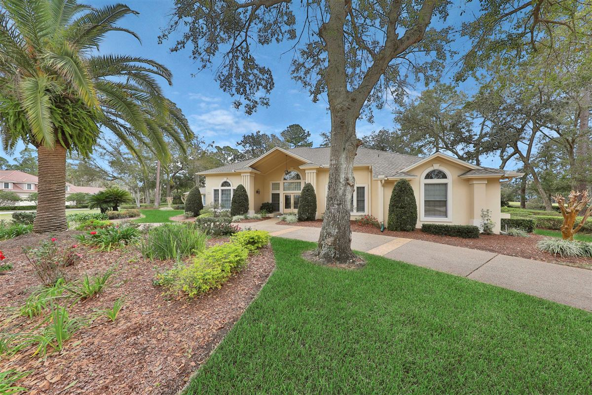 Mansions in beautiful lush landscaping surrounds this grand home