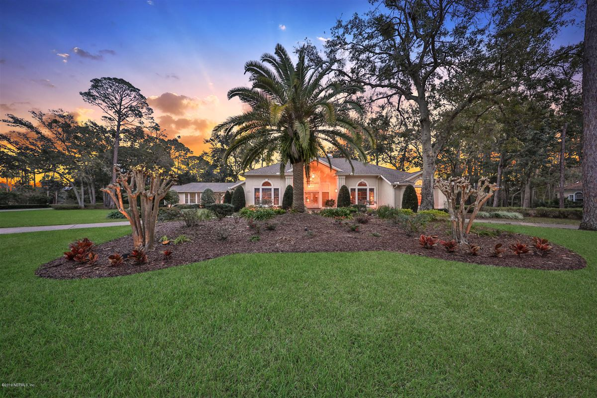 Luxury real estate beautiful lush landscaping surrounds this grand home