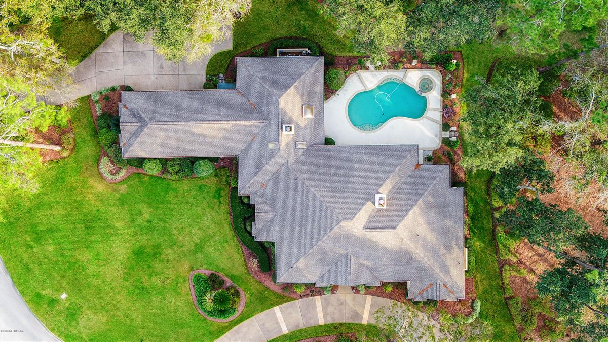 Luxury homes beautiful lush landscaping surrounds this grand home
