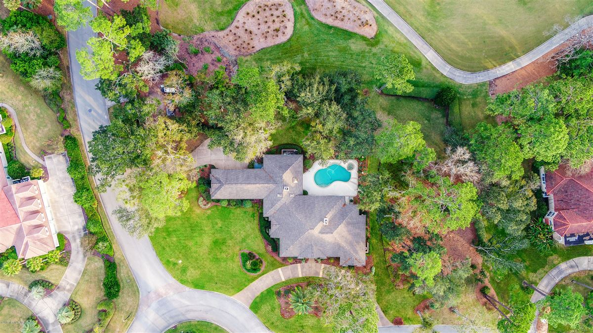 beautiful lush landscaping surrounds this grand home luxury homes