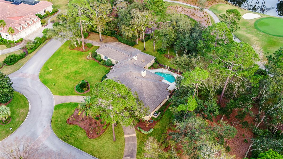 beautiful lush landscaping surrounds this grand home luxury real estate