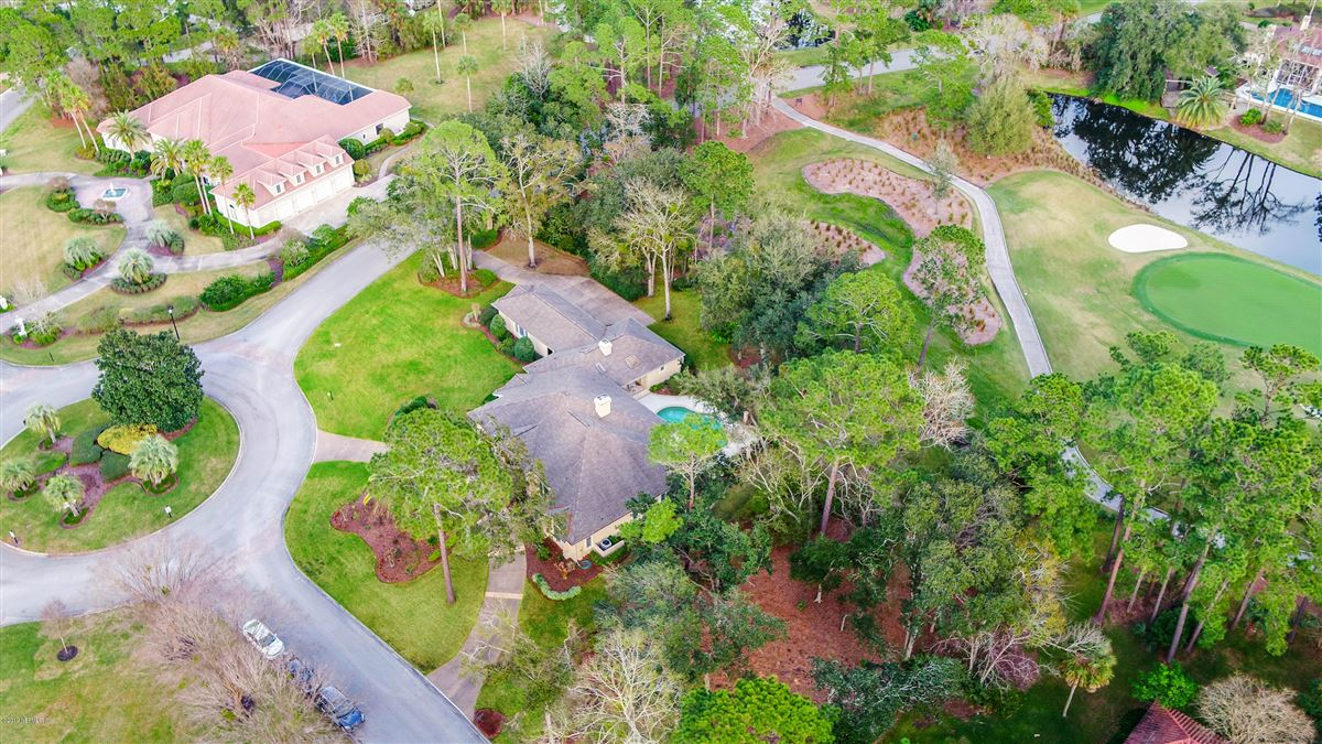 Luxury properties beautiful lush landscaping surrounds this grand home