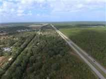 22.77 Acres with 2,107 ft frontage mansions