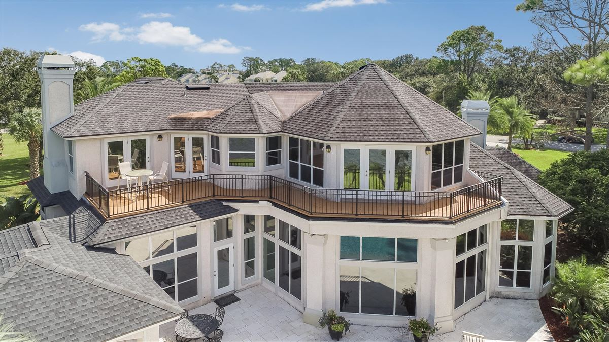 Welcome home to this spectacular lake-front home luxury homes