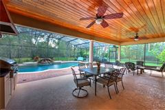breathtaking custom outdoor oasis nestled on 1.73 acre lot luxury properties