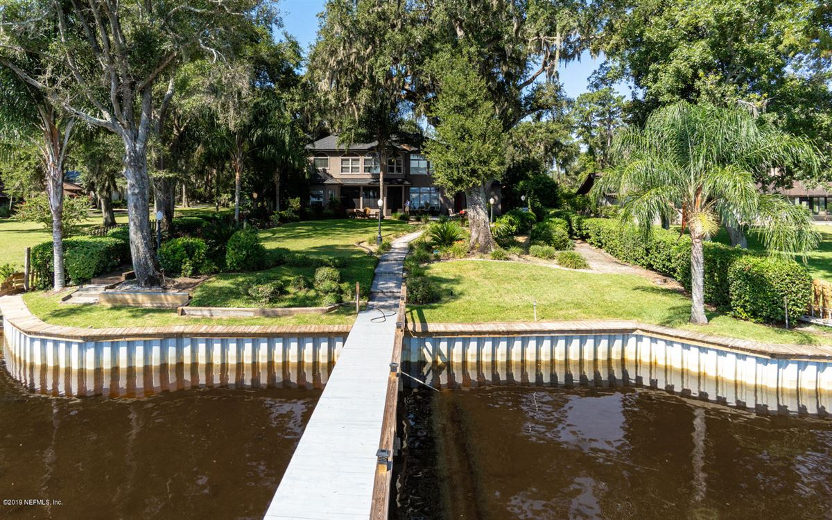 Mansions in Stunning Riverfront gated home
