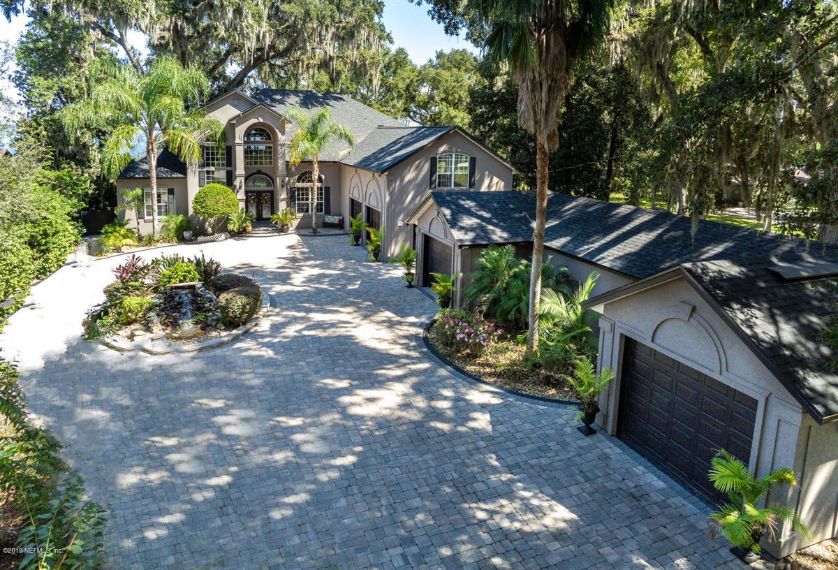 Stunning Riverfront gated home luxury homes