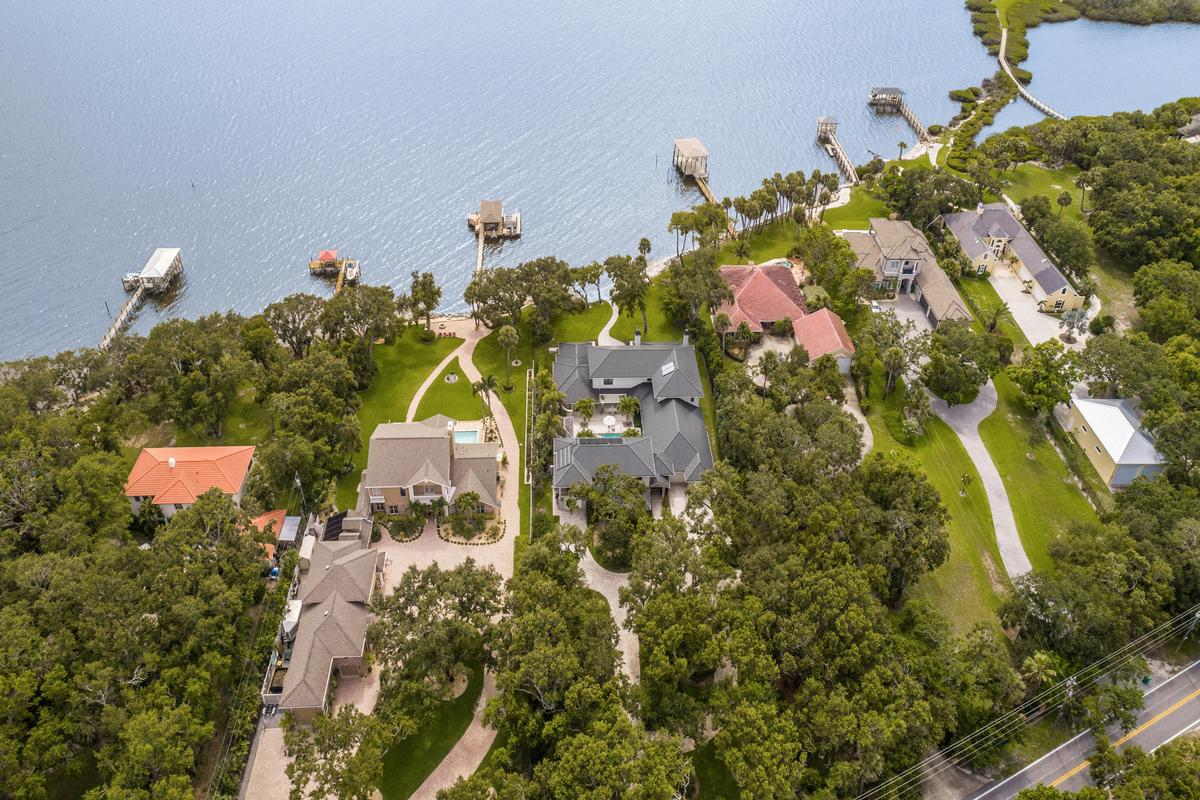Luxury properties spectacular gated riverfront home