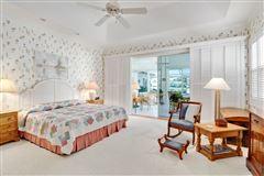 Pristine custom lakefront home luxury homes