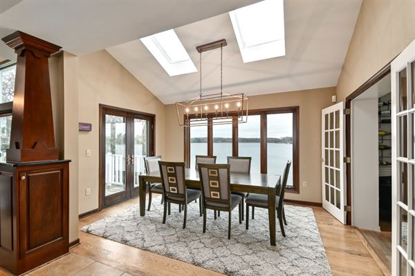 This spectacular updated lake home has over 230 feet of pristine frontage luxury properties