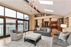 Mansions in This spectacular updated lake home has over 230 feet of pristine frontage