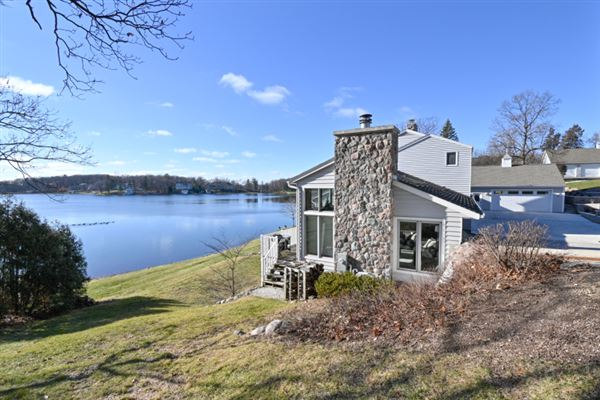 This spectacular updated lake home has over 230 feet of pristine frontage luxury real estate
