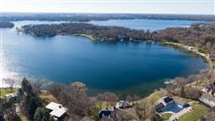 This spectacular updated lake home has over 230 feet of pristine frontage mansions